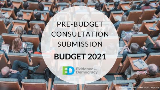 "The words ""Pre-budget consultation submission Budget 2021"" centred in a transparent white circle over an image of a lecture hall with people in the seats facing away from the viewer"